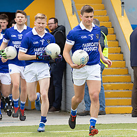 Cratloe captain Liam Markham leads his team onto the pitch for the Senior Football Championship Rd 1 against Clondegad at Cusack Pk on Sunday