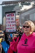"""San Francisco, USA. 19th January, 2019. The Women's March San Francisco begins with a rally at Civic Center Plaza in front of City Hall. During the rally, a woman wearing a pink """"Resist"""" sweatshirt holds a sign with a quote from Coretta Scott King: """"Women, if the sould of the nation is to be saved, [I believe that] you must become its soul."""" Credit: Shelly Rivoli/Alamy Live News"""