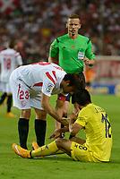 Coke (L) and J. Costa (R) and referee Alejandro J. Hernandez (C) during the match between Sevilla FC and Villarreal day 9 spanish  BBVA League 2014-2015 day 5, played at Sanchez Pizjuan stadium in Seville, Spain. (PHOTO: CARLOS BOUZA / BOUZA PRESS / ALTER PHOTOS)