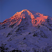 Alpenglow on Mount Rainier, as seen from the Paradise recreational area, is a gift of winter light. (Benjamin Benschneider / The Seattle Times)