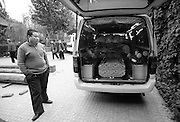 China's Aging Population 12 - A van carries the coffin of a deceased elderly person from a hospice.