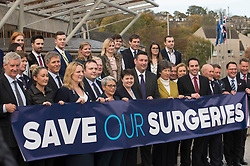 Scottish Conservatives leader Ruth Davidson is joined by Health Spokesperson Miles Briggs and other MSP's as they unfurl a banner outside the Scottish Parliament calling for increased spending for GP surgeries across Scotland, as part of their 'Save our Surgeries' campaign.<br /> <br /> © Dave Johnston/ EEm
