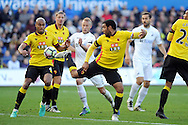 Swansea's Mike van der Hoorn © is surrounded by Watford's Younes Kaboul (l) and Troy Deeney (r). Premier league match, Swansea city v Watford at the Liberty Stadium in Swansea, South Wales on Saturday 22nd October 2016.<br /> pic by  Carl Robertson, Andrew Orchard sports photography.