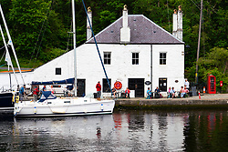 View of whitewashed Coffee Shop cafe beside canal basin on Crinan Canal at Crinan in Argyll & Bute, Scotland, Uk