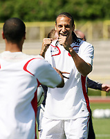 Photo: Chris Ratcliffe.<br />England training session. 07/06/2006.<br />Rio Ferdinand gets excitable in training.