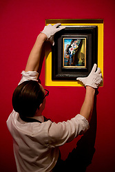 """© Licensed to London News Pictures. 22/02/2018. LONDON, UK. A member of staff holds  """"Gradiva"""" (1931) by Salvador Dalí, with an estimate of £1,200,000 - 1,800,000, on display at Sotheby's photo call for highlights from their forthcoming sales of Impressionist, Modern, Surrealist and Contemporary Art. Photo credit: ISABEL INFANTES/LNP"""