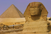 The Sphinx with the Great Pyramid of Khufu in the background at Giza, outside Cairo, Egypt.