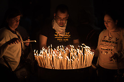14 April 2019, Jerusalem: Palm People light candles before Sunday service at the Church of the Holy Sepulchre, in the Old City of Jerusalem.
