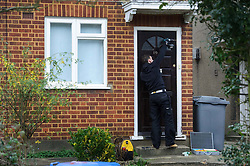 © Licensed to London News Pictures. 10/01/2014 Harrow, UK. A workman secures the door of a ground floor flat on Woodgrange Close, Harrow where the bodies of  a 33-year-old woman, a five-year-old boy and  a seven month old boy have been found. The deaths of the two children are being treated as murder the woman's death is not being treated as suspicious at this stage. Photo credit : Simon Jacobs/LNP