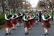 """Bagpipers at the 27th Saint .Patrick's Day Parade in Omotesando, Tokyo, Japan. Sunday March 17th 2019. Started in 1992 by the Irish Network, Japan, and supported by the Embassy of Ireland,; the parade, along with the """"I Love Ireland Festival"""" held nearby is Asia's  largest Irish event."""