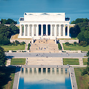 An elevated view of the Lincoln Memorial and part of the Reflecting Pool, seen from the top of the Washington Monument. The Washington Monument stands at over 555 feet (169 metres) at the center of the National Mall in Washington DC. It was completed in 1884 and underwent extensive renovations in 2012-13 after an earthquake damaged some of the structure.