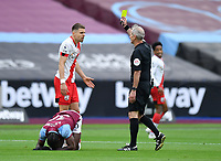 Football - 2020 / 2021 Premier League - Final Round - West ham United vs Southampton - London Stadium<br /> <br /> Southampton's Jan Bednarek yellow carded by Referee Martin Atkinson.<br /> <br /> COLORSPORT/ASHLEY WESTERN