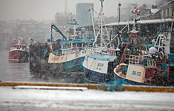 Licensed to London News Pictures. 05/12/2012. North Shields, UK,The poor weather and snow keeps fishing boats in port on the river Tyne at North Shields Fish Quay . Photo credit: Adrian Don/LNP