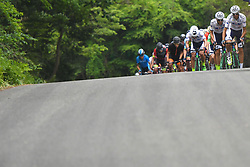 May 26, 2018 - Izu, Shizuoka, Japan - Members of Kinan Cycling Team with the Race Leader Marcos Garcia Fernandez lead the peloton during Izu stage, 120.8km on Izu-Japan Cycle Sports Center Road Circuit, the seventh stage of Tour of Japan 2018. .On Saturday, May 26, 2018, in Izu, Shizuoka Prefecture, Japan. (Credit Image: © Artur Widak/NurPhoto via ZUMA Press)