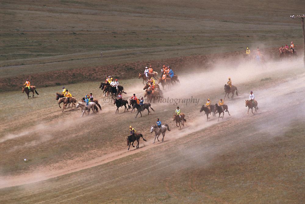 Naadam horse race<br /> Jockey's aged 4-12 years and most often girls<br /> Ulaanbaatar race track<br /> Mongolia