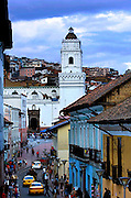 The bell tower of the Basilica of La Merced towers over the the colonial streets of old Quito, Ecuador.  The tower is the tallest in old Quito.