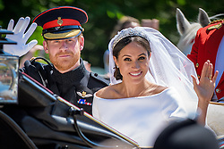 May 19, 2018 - Windsor, United Kingdom - An open top carriage carrying PRINCE HARRY and MEGHAN MARKLE leaves the chapel to make its way through Windsor after their wedding ceremony. The Bride's evening dress is designed by Stella McCartney and is a bespoke lily white high neck gown made of silk crepe. (Credit Image: © Andre Camara/London News Pictures via ZUMA Wire)