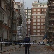 Police officer guarding  cordoned-off are in Park  Street, London