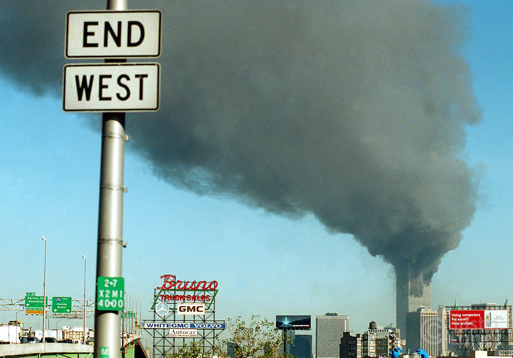The towers of the World Trade Center burn after being struck by hijacked planes on September 11, 2001.