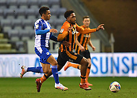Hull City's Josh Magennis battles for the ball<br /> <br /> Photographer Dave Howarth/CameraSport<br /> <br /> The EFL Sky Bet League One - Wigan Athletic v Hull City - Wednesday 17th February 2021 - DW Stadium - Wigan<br /> <br /> World Copyright © 2021 CameraSport. All rights reserved. 43 Linden Ave. Countesthorpe. Leicester. England. LE8 5PG - Tel: +44 (0) 116 277 4147 - admin@camerasport.com - www.camerasport.com