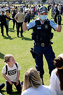 SYDNEY, NSW - SEPTEMBER 05: A policeman asks a family to move out of the area during the Freedom Day Rally on September 05, 2020 in Sydney, Australia. Protesters argue COVID-19 is a hoax and say their freedoms are being unfairly impinged. Demonstrations are also taking place in every Australian capital city and several regional areas, including Byron Bay. (Photo by Lucca Markham/Speed Media)