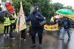 London, UK. 30th July, 2021. Royal Parks workers outsourced via French multinational VINCI Facilities dance on a picket line outside the Old Police House in Hyde Park as part of joint strike action by the United Voices of the World (UVW) and Public and Commercial Services (PCS) trade unions. The joint strike, with members dual carding over pay, conditions and the sacking of a member of staff, is believed to be the first between a TUC and a non-TUC trade union and follows the launch of a legal challenge by the Royal Parks workers against indirect racial discrimination by the Royal Parks.