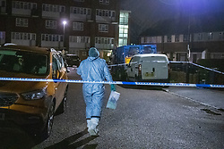 © Licensed to London News Pictures. 06/02/2021. London, UK. A forensic investigator walk into a cordon marked by police tape on Wisbeach Road. Metropolitan Police are investigating multiple incidents of serious violence, including a fatal stabbing, in south London. One case was reported at 20:08GMT on Wisbeach Road, Croydon, where two males had suffered stab injuries. One male was taken to hospital prior to police arrival; condition not life-threatening. Another male was found at the scene. Despite the best efforts of paramedics, he was pronounced dead at the scene. Photo credit: Peter Manning/LNP