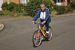 Older man riding a bicycle,