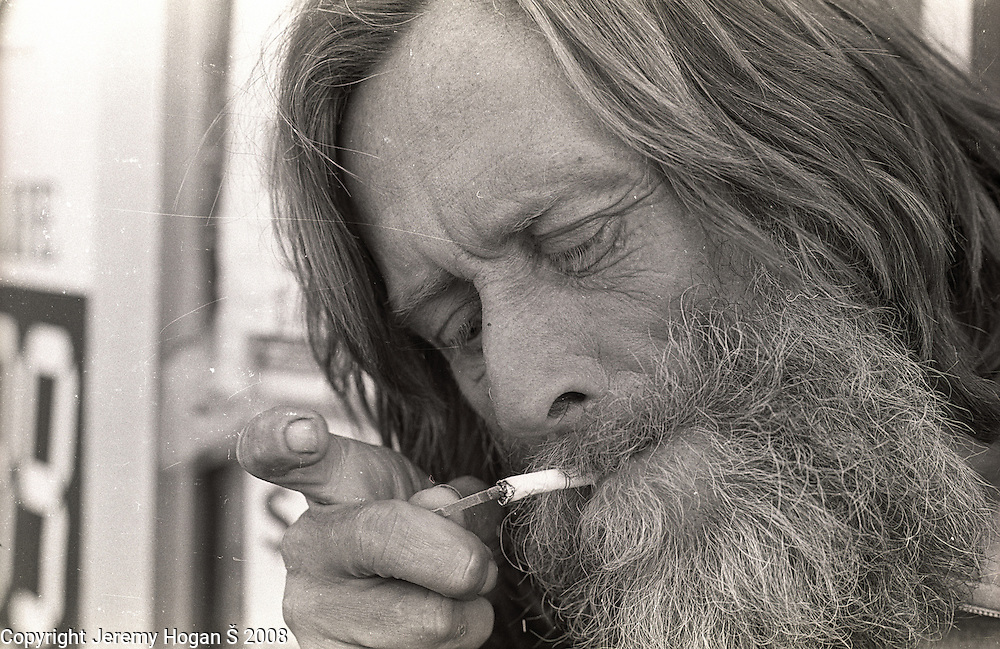 Skip Spence, of Moby Grape lights a cigarette outside T&P Liquors near where he was living in a half way house in early March 1994 in Downtown San Jose, Calif.