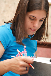Young woman with Cerebral Palsy studying.