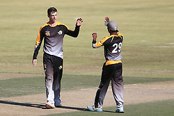 Kyle Simmonds of Boland is congratulated by Boland captain Keegan Peterson for getting Delano Potgieter of Gauteng wicket during the Africa T20 cup pool D match between Boland and Gauteng held at the Boland Park cricket ground in Paarl on the 25th September 2016.<br /> <br /> Photo by: Shaun Roy/ RealTime Images