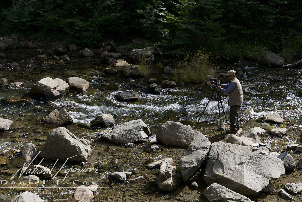 Jay gets in to the creek to get a shot of the waterfall known as Chorrillo del Salto near El Chalten, Argentina.