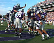 The Kansas State Wildcats celebrate after Josh Freeman's (1) go ahead touchdown late in the fourth quarter against Oklahoma State at Bill Snyder Family Stadium in Manhattan, Kansas, October 7, 2006.  The Wildcats beat the Cowboys 31-27.<br />