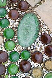 Decorative use of sunken, upturned bottles