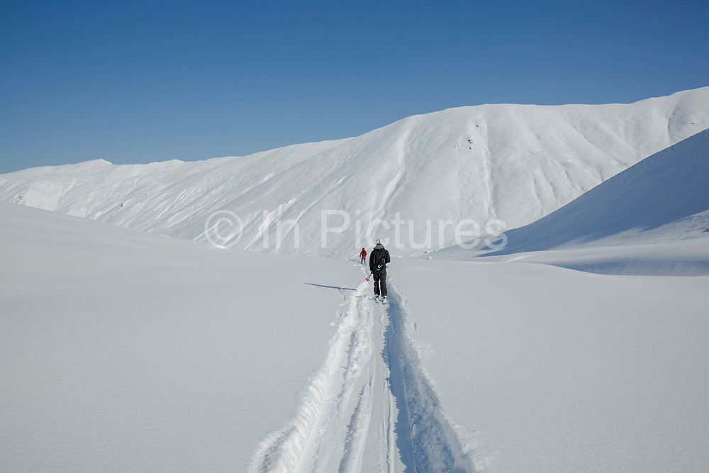 Two skiers cutting fresh tracks on the 4th March 2019 in Ayder in the Kackar Mountains in Eastern Turkey.