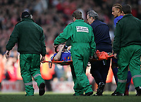 Photo: Lee Earle.<br /> Liverpool v Manchester United. The FA Cup. 18/02/2006. United's Alan Smith is stretchered off after a nasty injury.