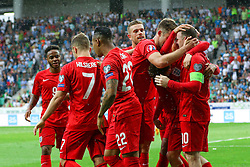 Wayne Rooney of England (R)  and other player scelebrate after scoring third goal for England during the EURO 2016 Qualifier Group E match between Slovenia and England at SRC Stozice on June 14, 2015 in Ljubljana, Slovenia. Photo by Vid Ponikvar / Sportida