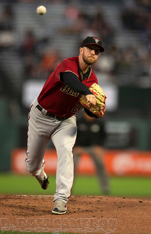 Sep 29, 2021; San Francisco, California, USA; Arizona Diamondbacks starting pitcher Merrill Kelly (29) delivers a pitch against the San Francisco Giants during the first inning at Oracle Park. Mandatory Credit: D. Ross Cameron-USA TODAY Sports