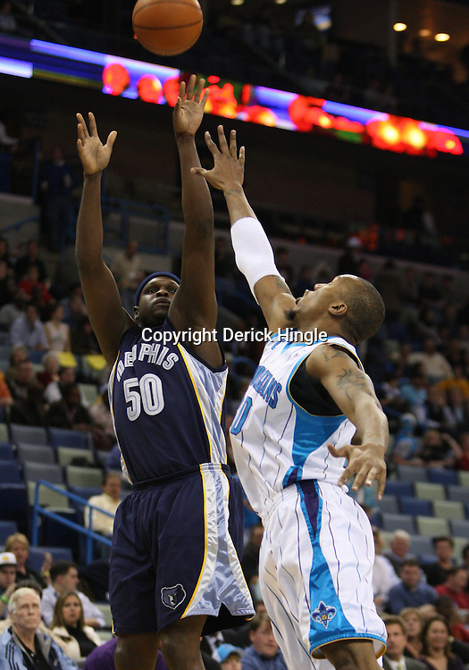 Mar 03, 2010; New Orleans, LA, USA; Memphis Grizzlies forward Zach Randolph (50) shoots over New Orleans Hornets forward David West (30) during the first half at the New Orleans Arena. Mandatory Credit: Derick E. Hingle-US PRESSWIRE
