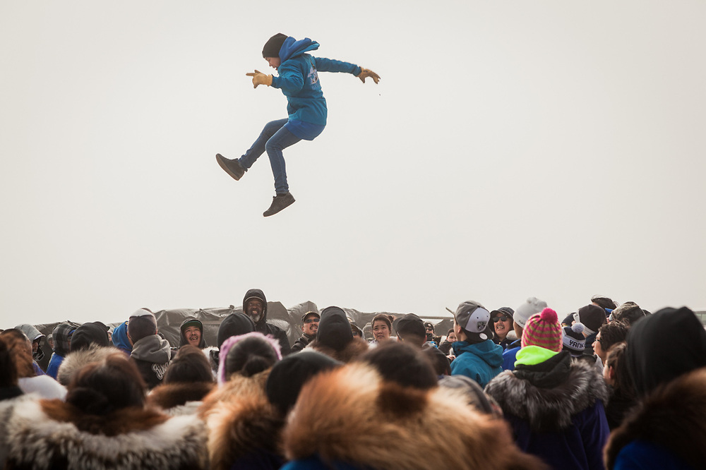 Blanket toss at Unagsiksiksauq (Clan Boat Celebration), Qagruq (Whaling Feast), Point Hope, The Purchase Centennial Poject
