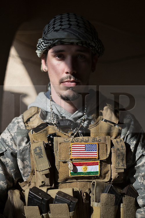© Licensed to London News Pictures. 19/02/2015. Dohuk, Iraq. A portrait of Brett, an American volunteer fighter serving with the Dwekh Nawsha Christian militia, taken in Dohuk, Iraqi-Kurdistan. Photo credit : LNP