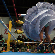 Cholita Carmen Rosa warms up before her bout during the 'Titans of the Ring' wrestling group performance at El Alto's Multifunctional Centre. Bolivia. The wrestling group includes the fighting Cholitas, a group of Indigenous Female Lucha Libra wrestlers who fight the men as well as each other for just a few dollars appearance money. El Alto, Bolivia, 24th January 2010. Photo Tim Clayton