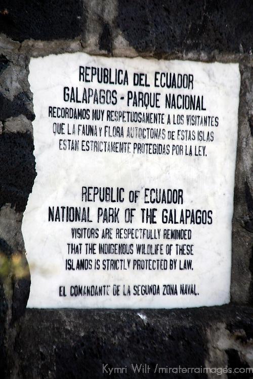 South America, Ecuador, Galapagos Islands, Santiago Island, James Island, Port Egas. Sign on the trail at Port Egas on James Island. (Santiago)