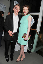 ROSS TOMLINSON and his sister ELEANOR TOMLINSON at a party hosted by Ines de la Frassange and Bruno Frisoni for Roger Vivier to launch the Roger Vivier book held at The Saatchi Gallery, London on 24th April 2013.