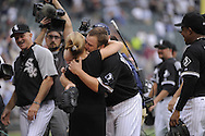 CHICAGO - JULY 23:  Mark Buehrle #56 of the Chicago White Sox hugs his wife Jamie and daughter Brooklyn after Buehrle recorded the 18th perfect game in major league history against the Tampa Bay Rays on June 23, 2009 at U.S. Cellular Field in Chicago, Illinois.  Buehrle pitched the 18th perfect game in major league baseball history as the White Sox defeated the Rays 5-0.  (Photo by Ron Vesely)