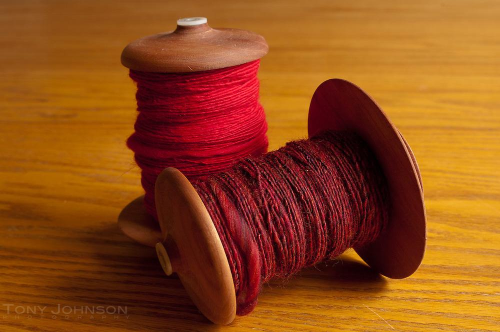 Handspun yarn on bobbins
