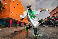 North Miami Senior High marching band member and graduate Sebastien Zephir makes a splash outside his home in Miami on Tuesday, May 19, 2020.