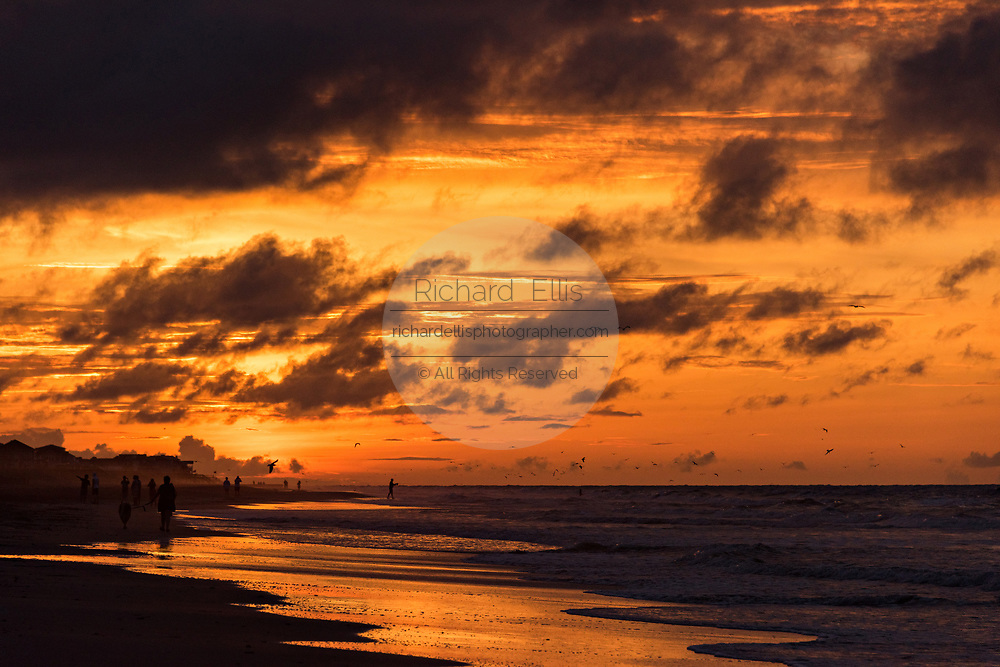 Dawn breaks on a cloudy morning June 5, 2017 in Folly Beach, South Carolina. Folly Beach is a quirky beach community outside Charleston known to locals as the Edge of America.