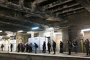 Commuters waiting for Overground train during rush hour at Denmark Hill station, South London, UK. This is one of the newer public transport lines on the TFL network.