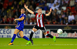 Leicester City's Ben Chillwell (left) and Sheffield United's Caolan Lavery battle for the ball during the Carabao Cup, Second Round match at Bramall Lane, Sheffield.
